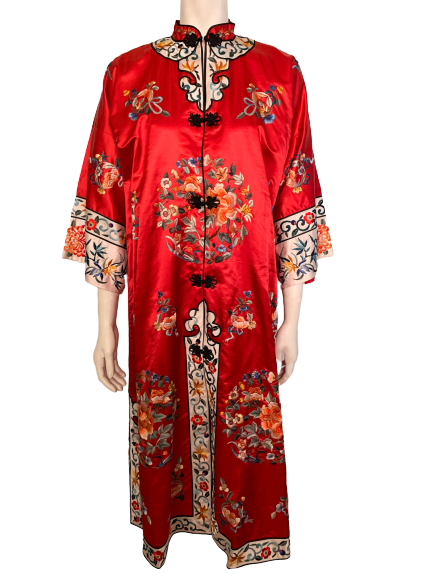 Front view of a mannequin in a red Chinese robe with floral embroidery