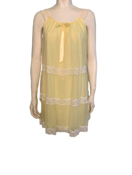 Front view of a mannequin in a yellow sleeveless negligee with white lace trim at the shoulders and bottom.
