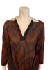 Bust close up of silk collar and open V neck atop sheer chevron print blouse