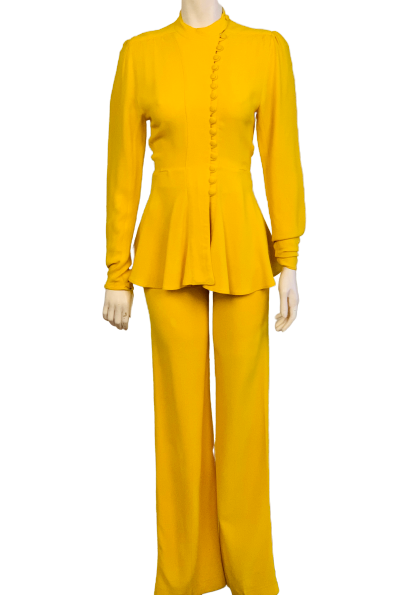 Marigold 2-piece set. High-neck, long-sleeve, asymmetrical, button-up jacket with slight peplum. High-waisted, wide-leg pants.