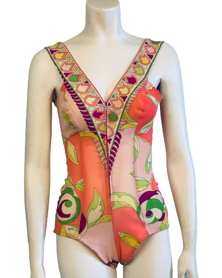 One piece bathing suit in Pucci print of  orange, pink, green, yellow, and cream. Elastic stretch fabric.  Deep V neck