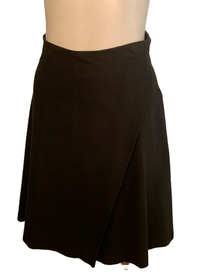 Black lycra/cotton skirt with side draping. Side zipper. Length is above the knee