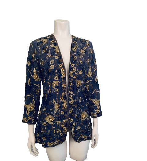 Front view of a blue jacket with gold floral beading on a mannequin