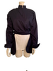 Navy cotton jacket with cropped front and back tails. Front fabric wraps across the body. High neck and cuffed sleeves.