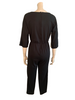 Black cotton/polyester jumpsuit with elastic waist and three quarter sleeves. On the top right is a creme panel with three rust leaves embroidery.