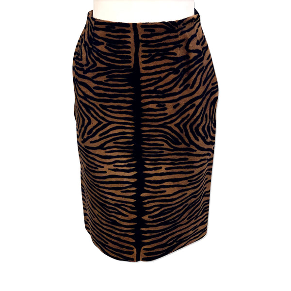 Front view of mannequin wearing brown & black tiger stripe printed pony hair pencil skirt.