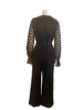 Back view of mannequin in a 70s black jumpsuit with long lace sleeves and a ruffle at the V neck