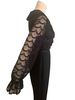 Side view of mannequin in a 70s black jumpsuit showing its long sheer lace sleeves