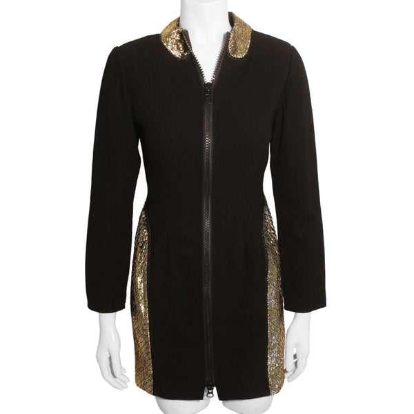 Full length front view of mannequin wearing Geoffrey Beene black wool zip-up mini dress with gold metallic quilted sides.