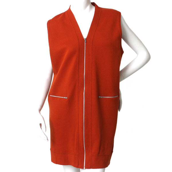 Burnt orange, v-neck, zip-up, knit vest with 2 zip pockets.