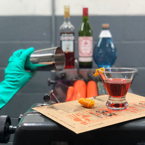 A little cocktail being added to the ink of 33 Cocktails while on press.