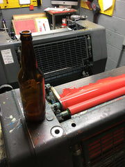 Adding a little home-pressed cider to the ink on press.