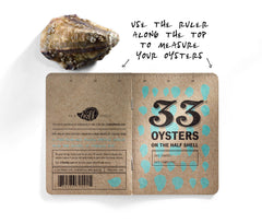 Use the ruler along the top of the book to measure the length of your oyster