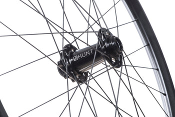 <html><h1>Front Hub</h1><i>We have gone all out on the front hub and beefed it up over our XC Wide and Trail Wide wheelsets. Featuring an oversized shell to accommodate larger and extremely durable bearings and 7075-T6 series alloy axles to increase stiffness. These hubs have been selected based on their ability to perform on the most aggressive trails. </i></html>
