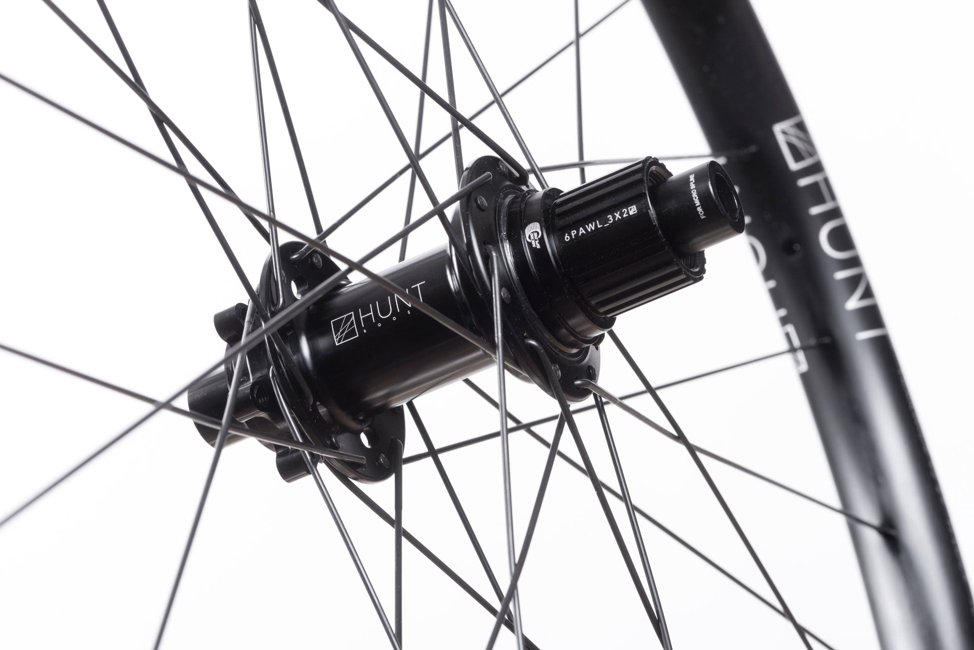 <h1>Rear Hub</h1><i>We create wheels to match the needs of riders who want the most from their wheels. The Trail Wide hubs have been chosen to increase stiffness, bearing durability and overall strength of your wheelset. On the rear, the RapidEngage MTB hubs with a fast 5 degree engagement, means you will be able to clear those janky tech climbs with ease.</i>