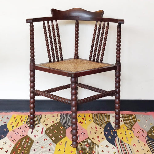 Antique hand turned corner bobbin chair with french cane seat