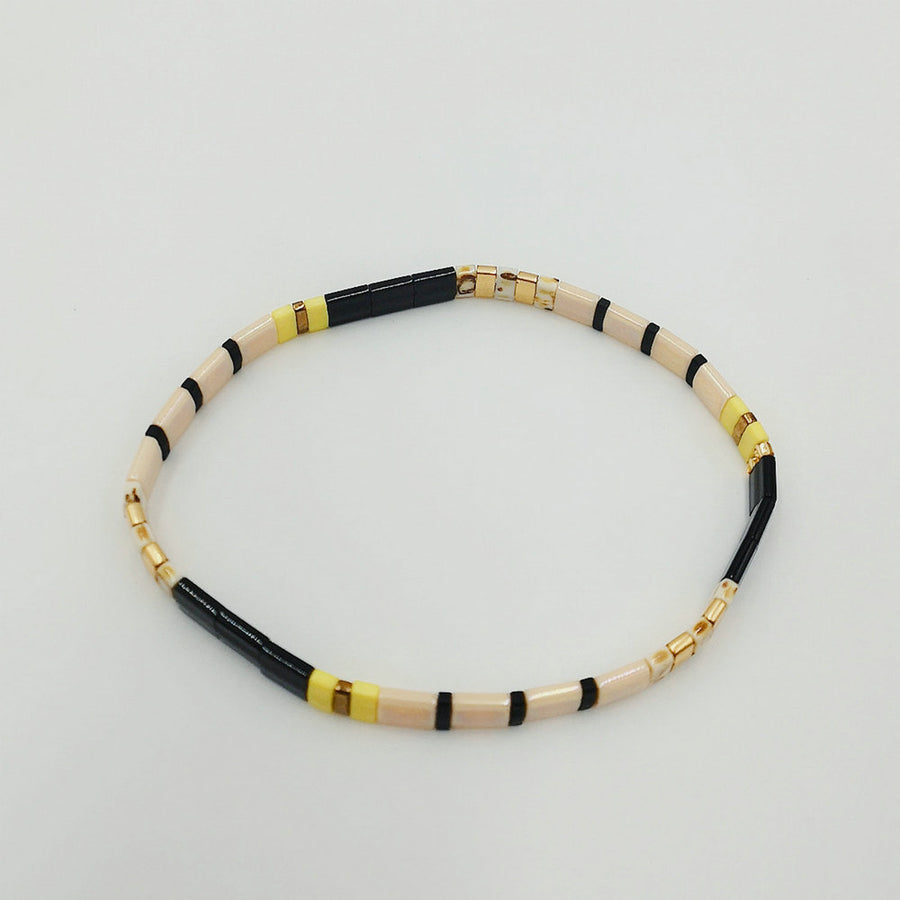 Delicate beaded bracelet yellow beige black and gold