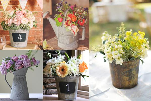 Six buckets of flowers presented as ideas for a rustic wedding centrepiece