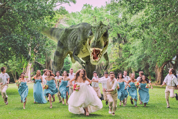 A photoshopped photograph of a wedding party running away from dinosaurs