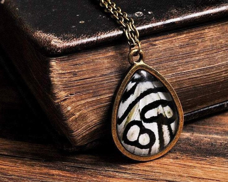 Butterfly wing necklace, tear drop necklace, antique brass necklace, tear drop pendant, glass necklace, grey necklace, butterfly necklace