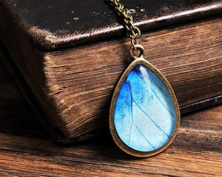 Butterfly wing necklace, tear drop necklace, antique brass necklace, tear drop pendant, glass necklace, blue necklace, butterfly necklace