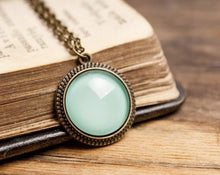 Load image into Gallery viewer, Tiny mint green necklace, mint green pendant, brass pendant, glass dome pendant, antique bronze pendant, brass necklace, glass dome necklace
