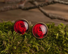 Load image into Gallery viewer, Red rose earrings, red flower earrings, antiqued brass earrings, rose post earrings, rose stud earrings, antique bronze / silver plated