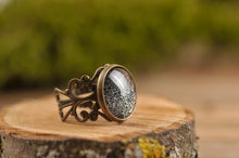 Load image into Gallery viewer, Starry night ring, filigree ring, sparkly black ring, adjustable ring, statement ring, antique brass ring, glass dome ring, ornament ring
