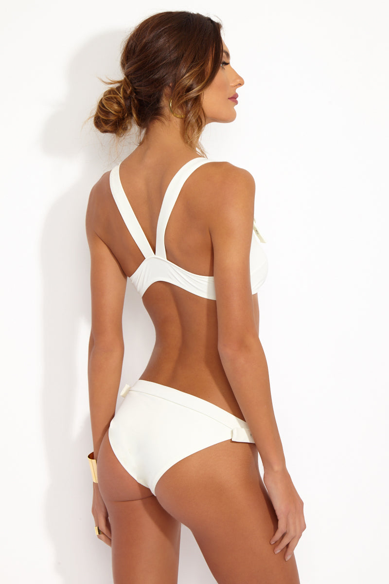 SOLID & STRIPED The Evelyn Buckle Bottom - Cream Bikini Bottom | Cream| Solid & Striped Back View of The Evelyn Buckle Bottom Low rise cream bikini bottom with adjustable side straps and circular buckle closures.