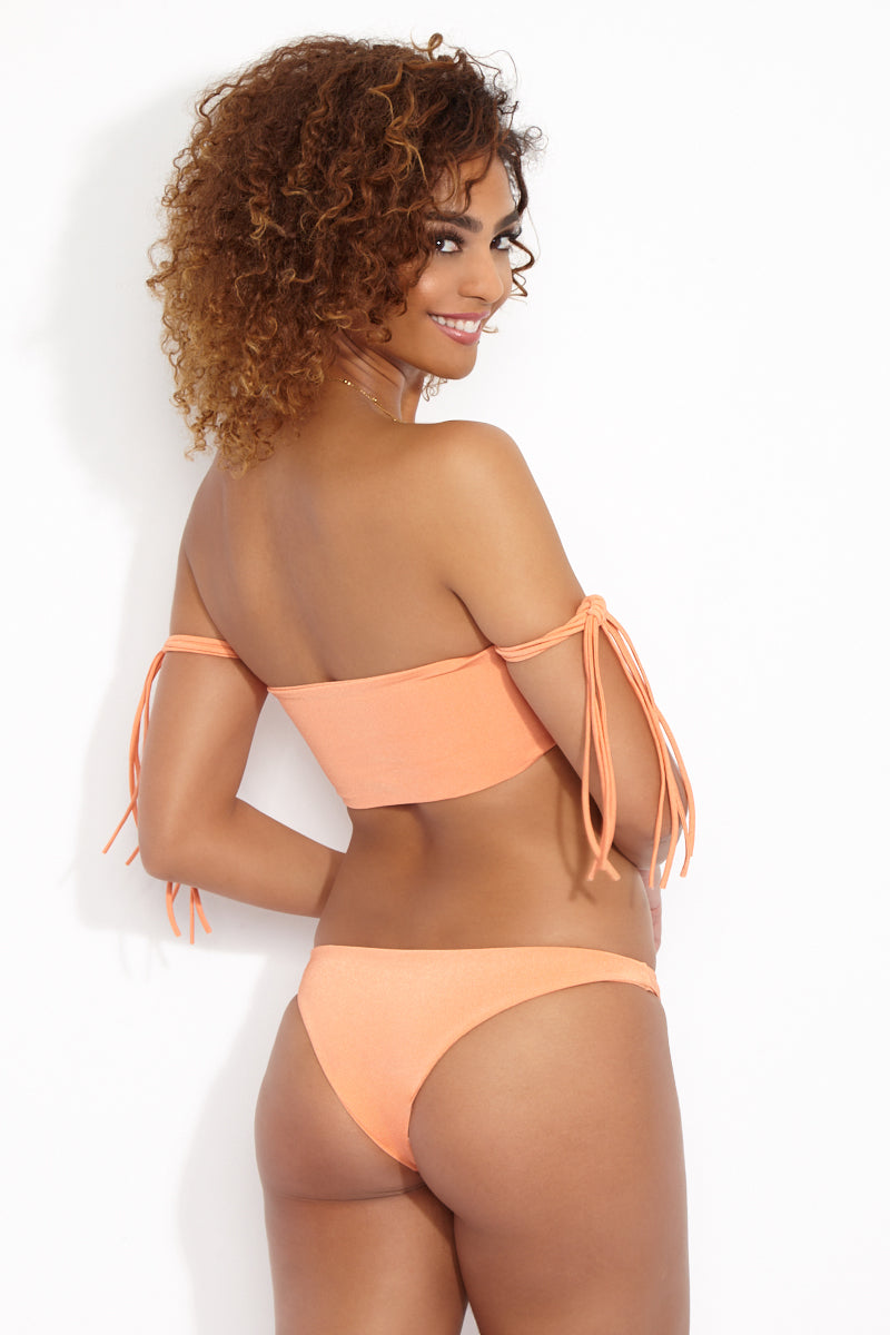 WILDASTER Blake Moderate Bottom - Peach Sorbet Bikini Bottom   Peach Sorbet   Wildaster Blake Moderate Bottom - Orange Back View Low Rise Bottom  Cheeky-Moderate Coverage  Seamless Stitching Double Lined  80% Nylon / 20% Spandex