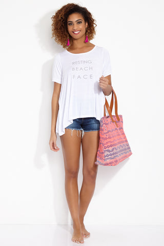ETE APPARELS Resting Beach Face Oversize Tee - White Resort Top | White| Ete Apparels Resting Beach Face Oversize Tee - White Front View Oversized Tee Short Sleeves A -Line Cut   Gray Font Across Chest in All Caps  Fabric: Micro Modal