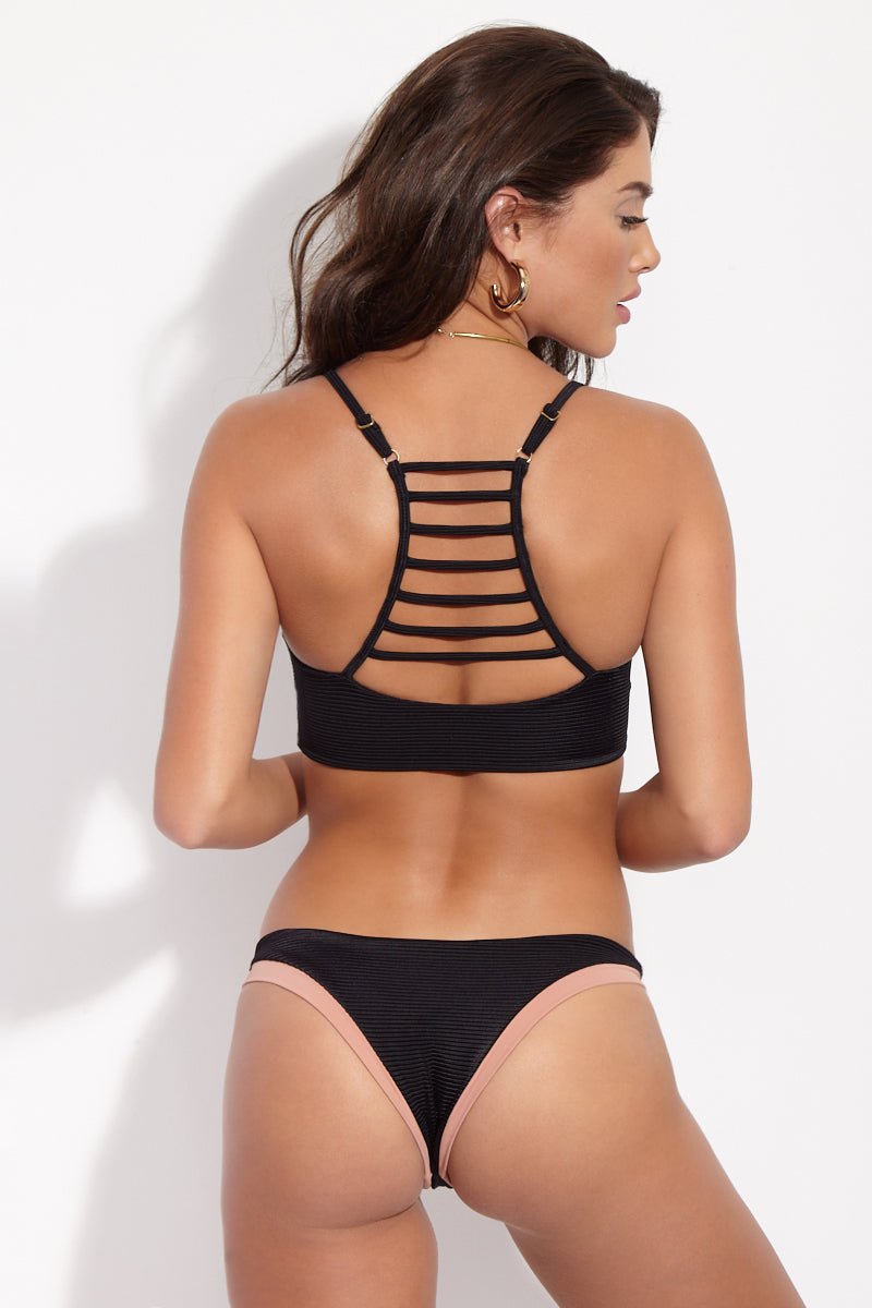 ISSA DE' MAR Bondi Top - Black Ribbed Bikini Top | Black Ribbed| Mauka/Tan| Issa De Mar Bondi Bikini Top Nude and black color blocked bikini top with a scoop neckline. Spaghetti straps and ladder strap detail on the back. Wide back band with no closure.
