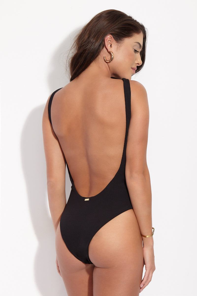BEACH BUNNY Rib Tide Lace Up One Piece - Black One Piece   Black  Beach Bunny Rib Tide Lace Up One Piece - Black. Back view. Black lace up front one piece. High Neckline. High cut leg. Low scoop back. Moderate Coverage. Ribbed Fabric.