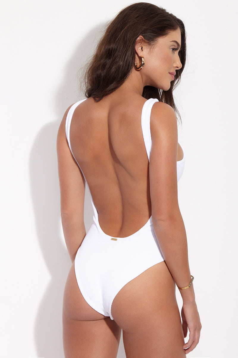 BEACH BUNNY Rib Tide Lace Up One Piece - White One Piece | White| Beach Bunny Rib Tide Lace Up One Piece - White. Back View. High neckline. High cut leg. Low scoop back. Moderate Coverage. Ribbed Fabric.