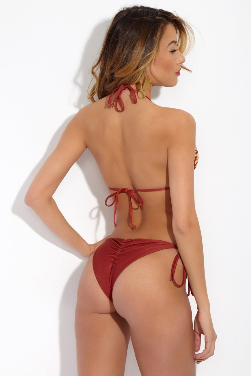d48e85825975 STYLE Turn heads in this super-sultry bikini bottom.Striking burnt-red  fabric looks almost leather-like