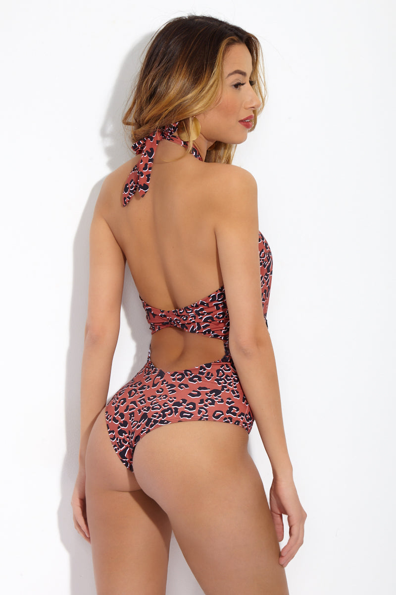 BEACH RIOT Cori Tasseled Halter One Piece - Leopard Print One Piece | Leopard Print| Beach Riot Cori One Piece Criss cross halter neck one piece. Leopard print. Front cut out with tassel detail. High cut leg. Adjustable halter ties. Back cut out. Cheeky coverage.
