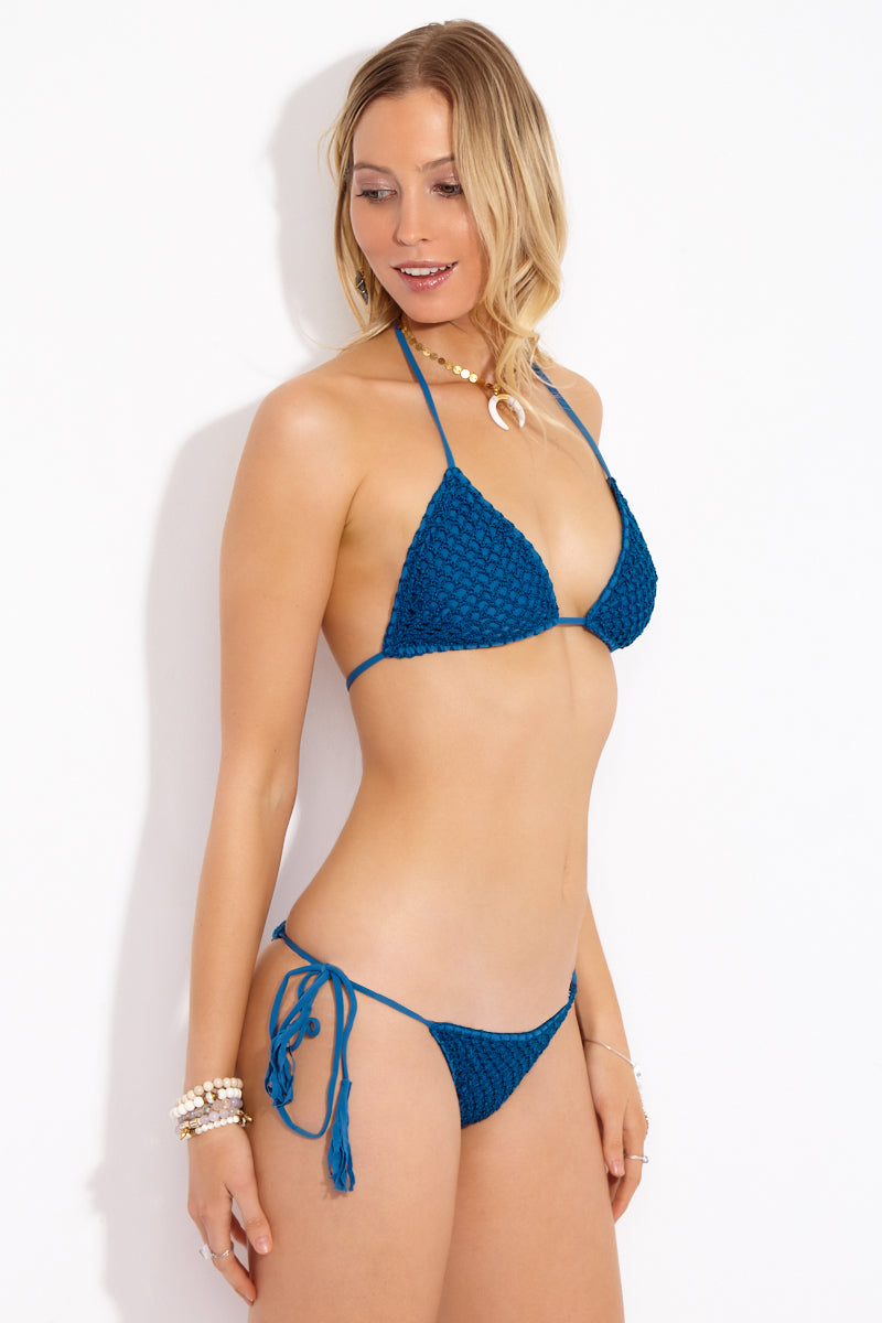 ACACIA Humuhumu Triangle Top - Salt Water Bikini Top | Salt Water| Acacia Humuhumu Triangle Top - Salt Water Side View Triangle bikini top in deep sea blue fabric. Crochet overlay. Adjustable ties at neck and back. Double lined in Acacia's signature snakeskin print fabric.