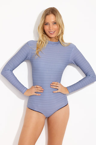 ACACIA Ehukai Longsleeve One Piece - Long Island One Piece | Long Island| Acacia Ehukai Longsleeve One Piece - Long Island Front View Long sleeve one piece swimsuit with high neck. Thin dark blue and white horizontal stripe print. Mid-rise leg cut. White zipper back closure. Moderate coverage.