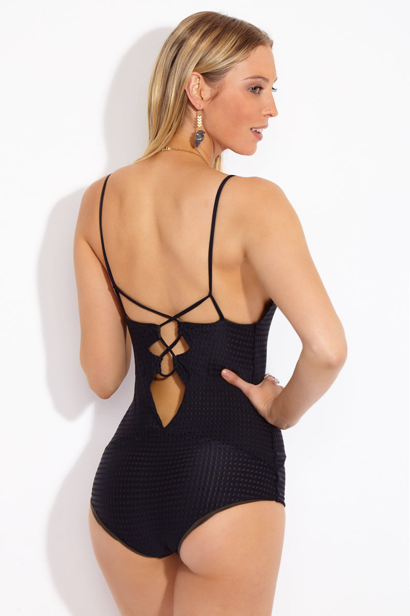 ACACIA Kokomo Strappy Front One Piece - Black Beauty One Piece | Black Beauty| Acacia Kokomo Strappy Front One Piece - Black Beauty Back View Black one piece swimsuit with perforated mesh overlay. Strappy cut outs on torso. Low scoop neckline. Spaghetti straps. Strappy cut outs at the back. Moderate to full coverage.