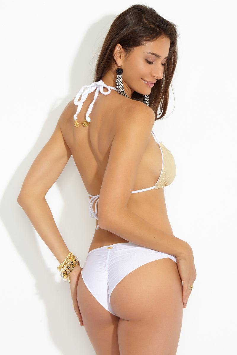 LULI FAMA Reversible Zig Zag Knotted Cut Out Triangle Top - White Bikini Top | White| Luli Fama Reversible Zig Zag Knotted Cut Out Triangle Top Gold Back View Seamless Reversible Triangle Bikini Top Kelly White Side Glittery Gold Side Knotted Cut Out Design at Bust Adjustable Braided Halter String Ties Adjustable Ties at Back