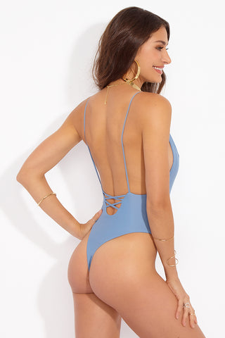MIA MARCELLE Lola One Piece - Sea One Piece | Sea|Lola One Piece - Features:  Minimal coverage One piece Scoop back with lace up style criss cross string detail String strap High leg cut Thong style back