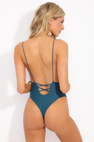 MIA MARCELLE Lola One Piece - Teal One Piece | Teal|Lola One Piece - Features:  Teal color minimal coverage One piece Scoop back with lace up style criss cross string detail String strap High leg cut Thong style back