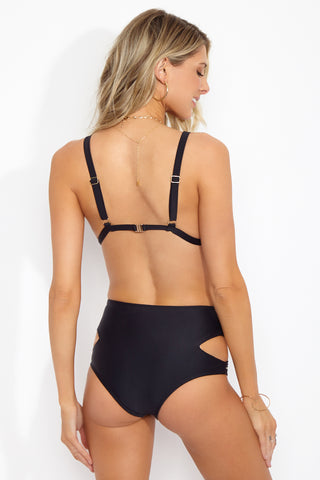 BEACH RIOT Alex Classic Triangle Bikini Top - Black Moon Bikini Top | Black Moon| Beach Riot Alex Classic Triangle Bikini Top - Black Moon. Back View. Classic Triangle top. Metallic beaded detail. Adjustable shoulder straps. Back hook closure. Nylon/spandex blend. Hand wash cold; lay flat to dry. Made in USA.