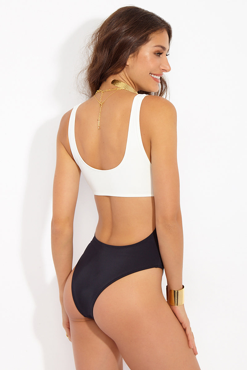 SOLID & STRIPED The Natasha Central Cutout One Piece - Cream/ Black One Piece | Cream/Black| Solid & Striped The Natasha Central Cutout One Piece - Cream/ Black Front View Wide Scoop Neckline  Thick Shoulder Straps Can Be Worn Off Shoulders Center Cutout High Cut Leg  Cheeky Coverage