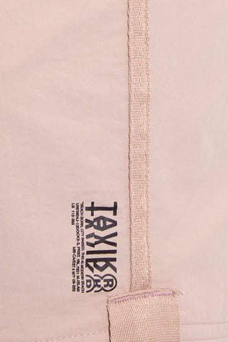 TAVIK MENS Catera Pockets Mid Length Swim Trunks - Rose Dust Mens Swim | Rose Dust| Tavik Mens Catera Pocket Mid Length Swim Trunks - Rose Dust. Detailed View. Dual front pockets. Concealed drawcord system. Inset elastic at waistband. Rear pocket with button closure. Webbing tape details.