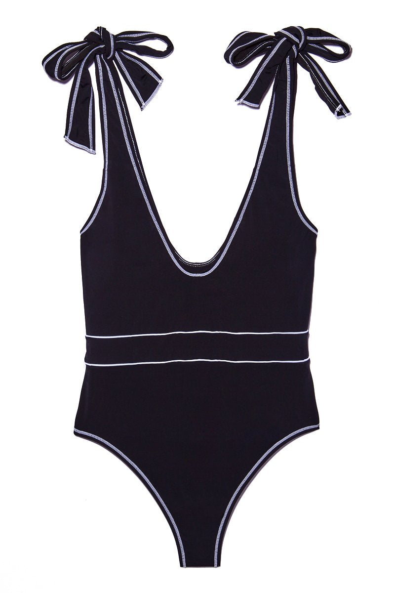 BEACH JOY Tie Shoulder One Piece - Licorice One Piece   Licorice Tie Shoulder One Piece Flat Lay View. Features:  Black plunging one piece Adjustable string tie shoulder style Belt-like white lines at middle Cheeky style butt Minimal coverage