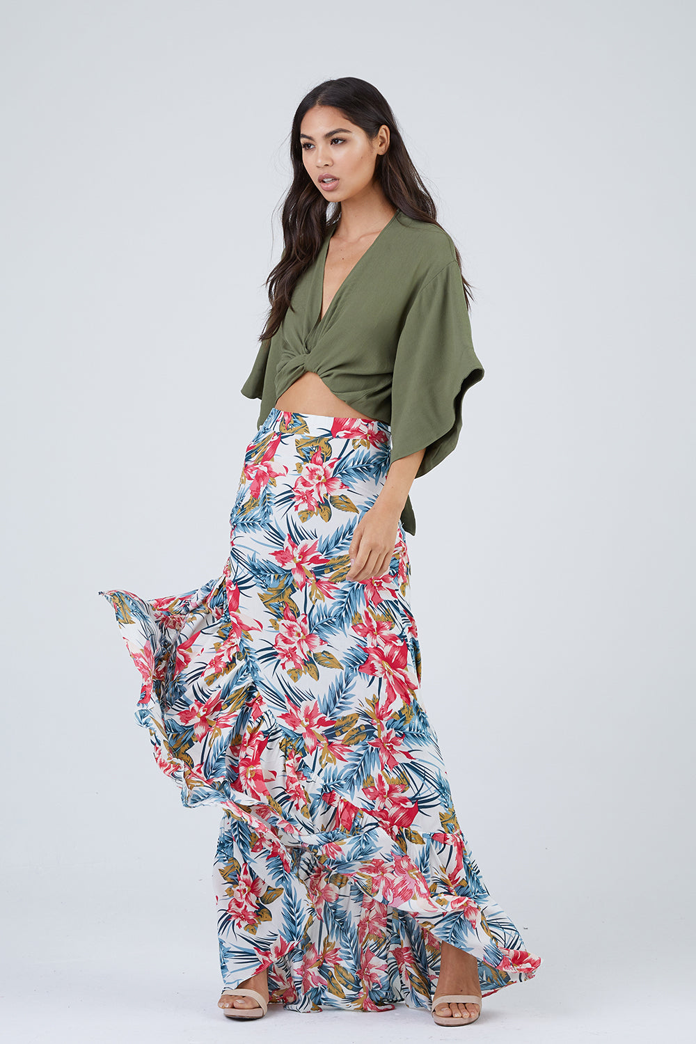 b8f319be STYLE:Vintage-inspired high-waisted ruffled hem maxi skirt with a high slit  in a vacation-ready tropical floral print.The full-length cascading ruffled  ...