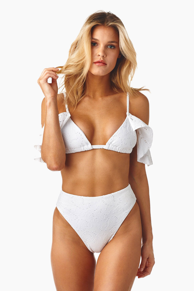 a136a4e9985 STYLE:Triangle bikini top with ruffle sleeves in stretchy white eyelet  embroidered fabric.Soft sliding triangle cups with adjustable spaghetti  straps give ...