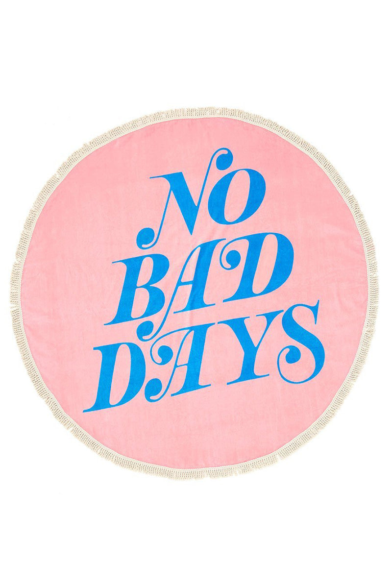 "BAN.DO No Bad Days All Around Giant Circle Towel Accessories | pink|No Bad Days All Around Giant Circle Towel Pink oversized round shaped towel with ""No Bad Days"" blue lettering surface design and cotton tassels around edge."