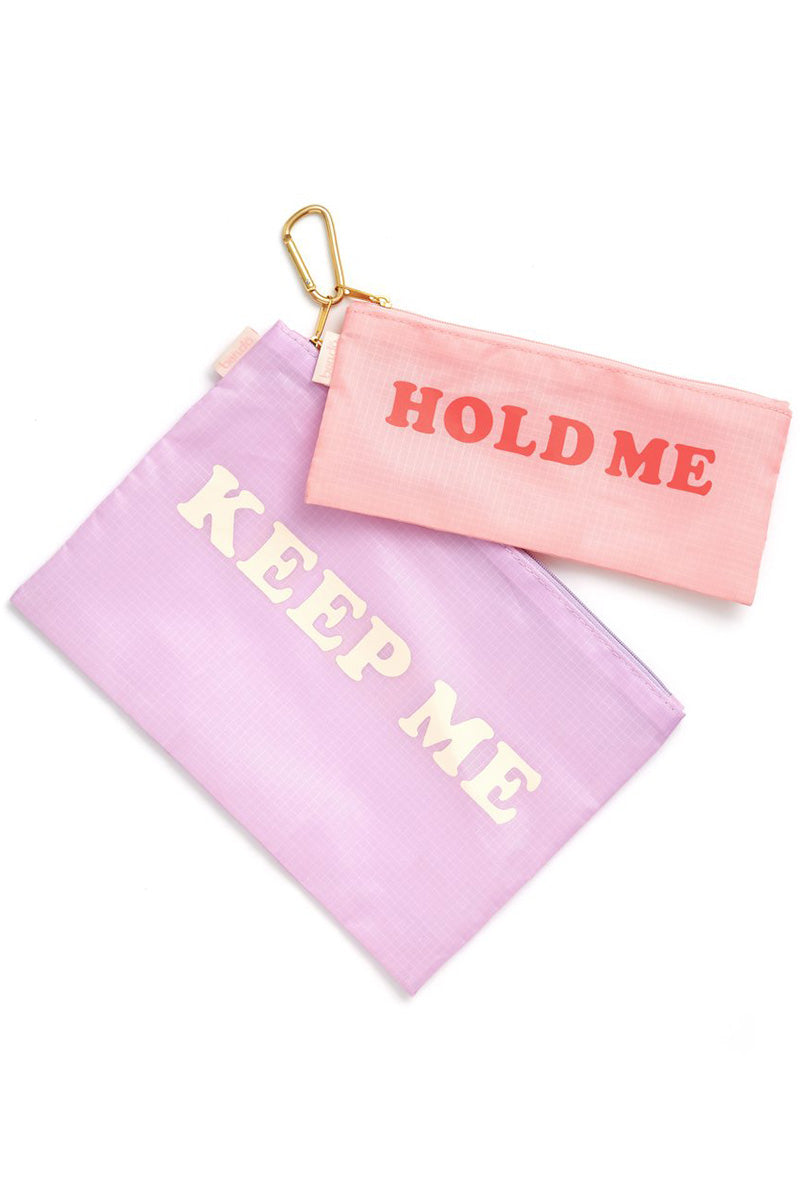 """BAN.DO Hold Me Keep Me Carryall Duo Accessories   Purple Hold Me Keep Me Carryall Duo Two nylon carryall pouches with graphic """"Hold Me"""" and """"Keep Me"""" text and metallic gold tone hardware."""